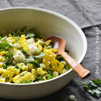 Mexican-Inspired Warm Garlic Butter Corn Salad with Cotija